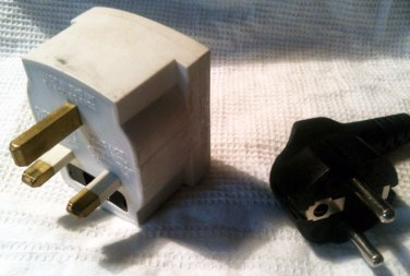 Left: plug converter from European to UK. Right: European (Dutch) plug.