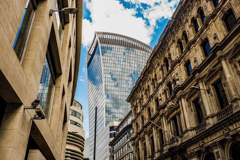 the modern Walkie Talkie building in London stands out in the street