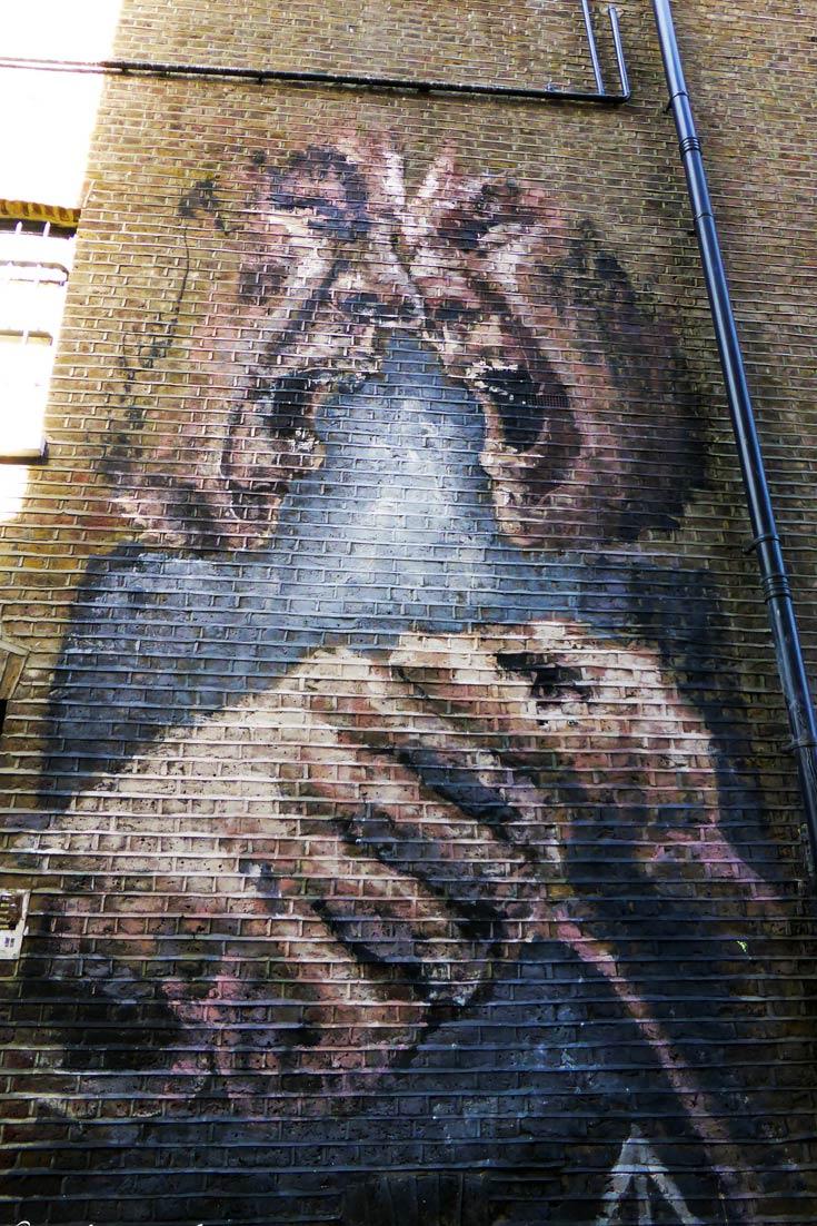 artwork of two shouting men in Camden on Miller Street