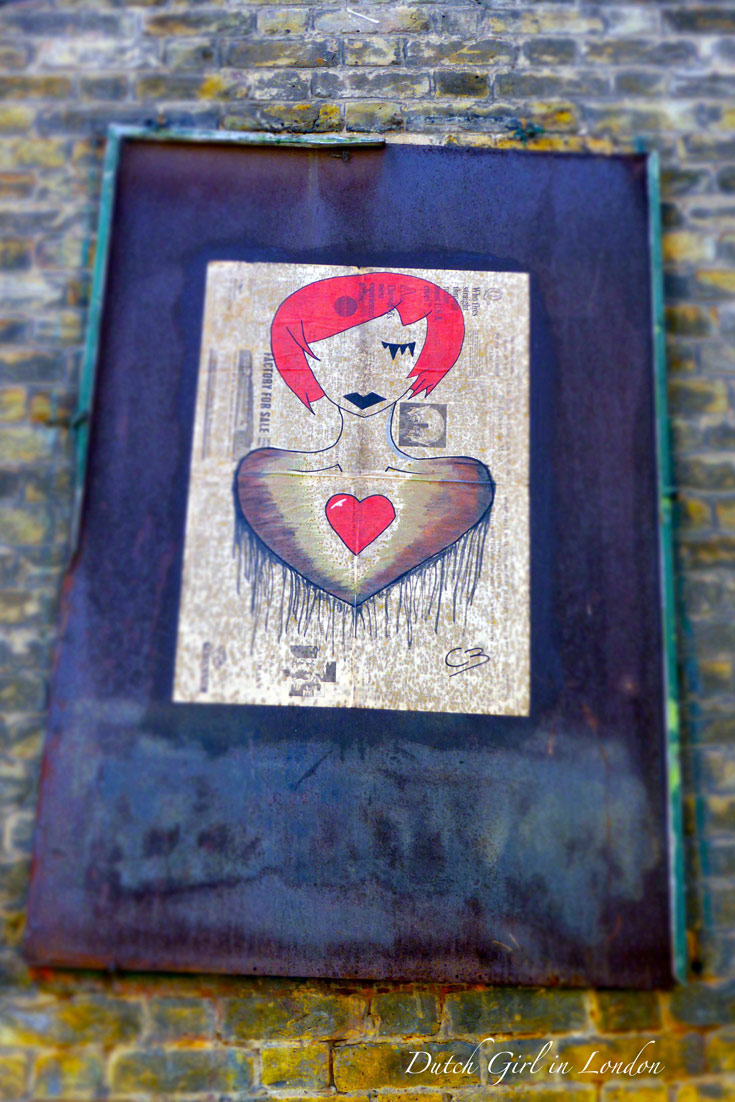 street art paste-up drawing of a women with red hair