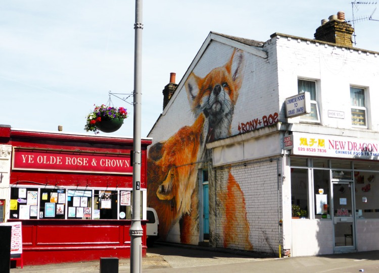 Irony Boe street art of two foxes in Walthamstow