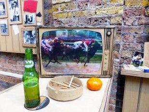 Horse racing TV broadcast in 'A Proper East End Pub'