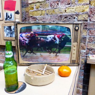 Horse racing TV broadcast in 'A Proper East End Pub'
