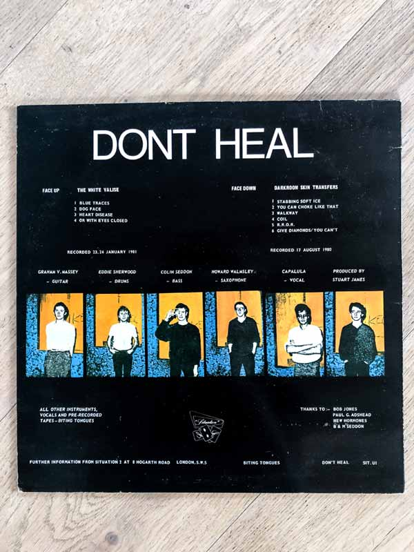 Biting Tongues vinyl sleeve of Don't Heal album back
