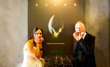 Our wedding photo in front of the Alien (1979) film poster in the cinema