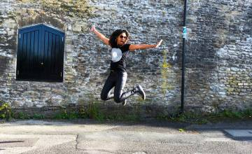 Dutch Girl in London jumping in the air in Frome Somerset