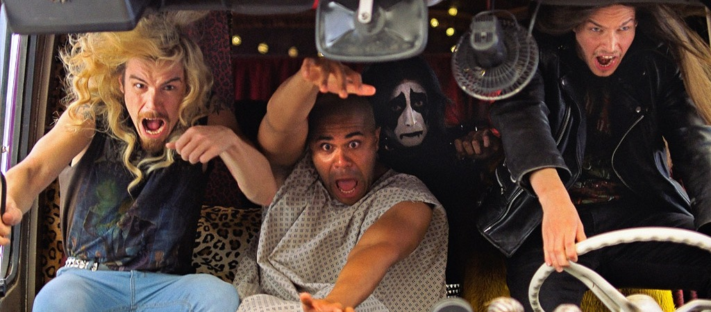 Still from Heavy Trip black metal film with the band members being tossed around in the van