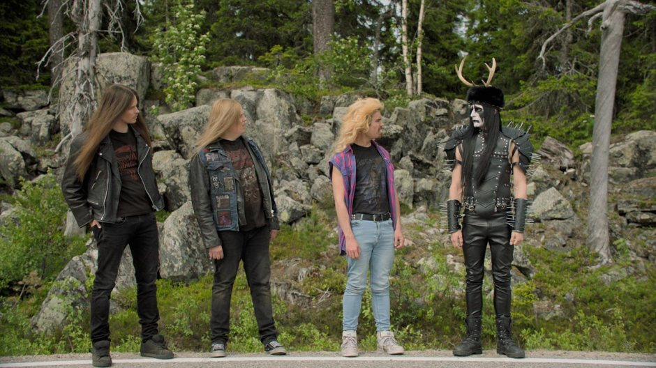 Still from the film Heavy Trip where bassist Pasi reveals his black metal look
