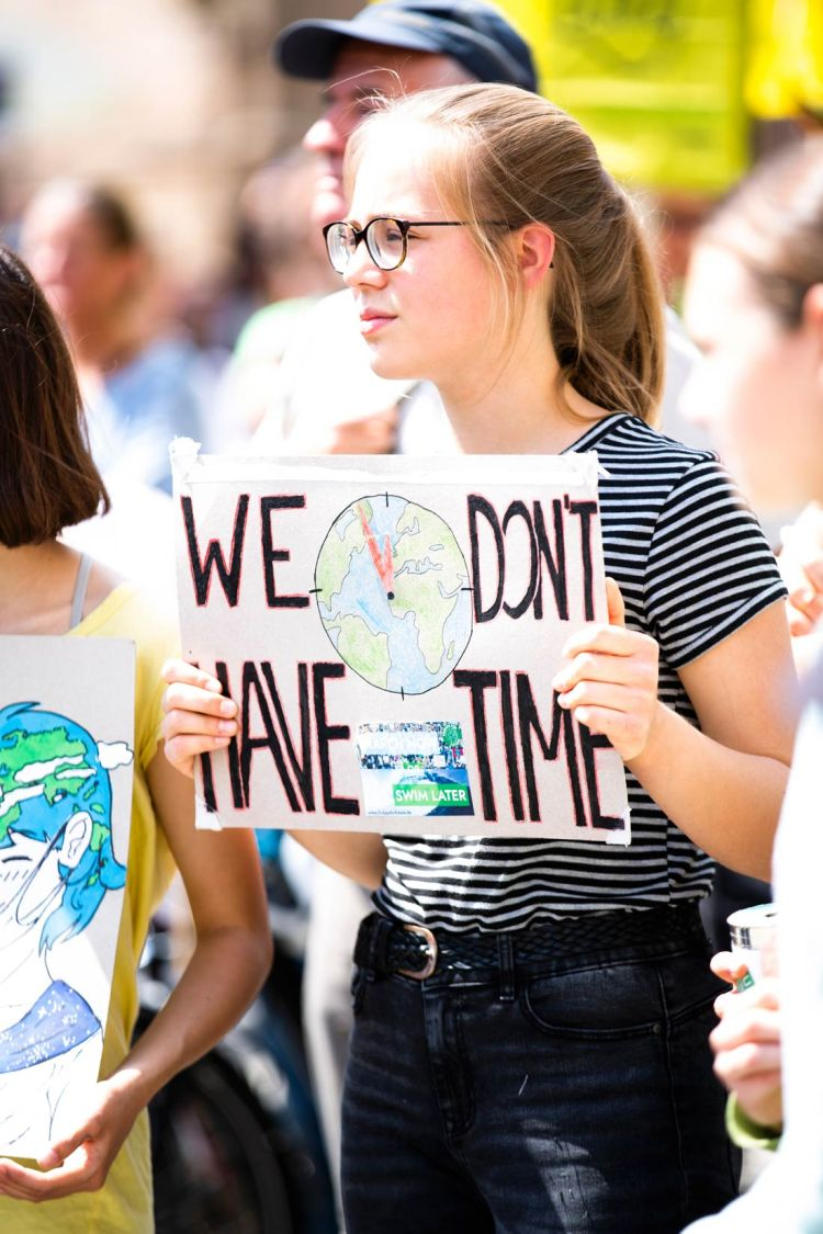 Girl holding a sign during the Friday's For Future climate strike