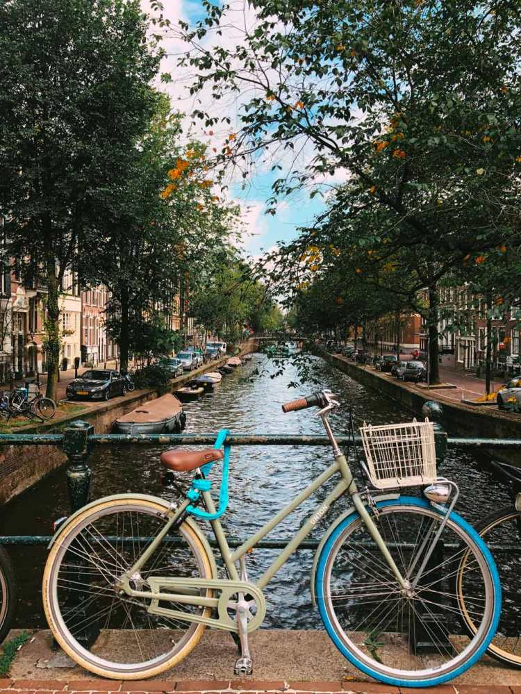 Amsterdam canals with a typical Dutch bike in the foreground