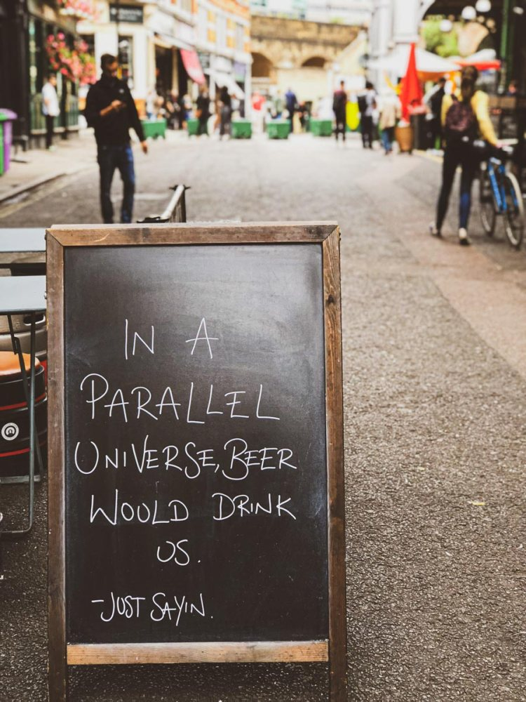 Pub sign at Borough Market London saying 'In a parallel universe beer would drink us'