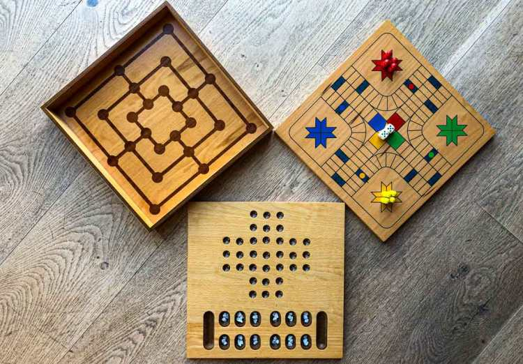 Three board games: Ludo, Mancala and Mills