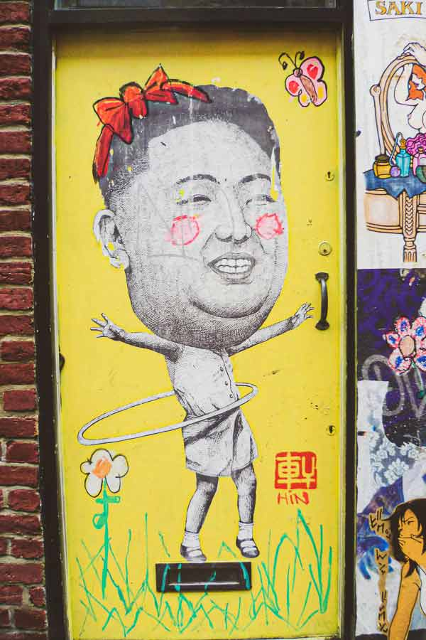 Shoreditch paste-up by HIN of Kim Jong-il hula hooping