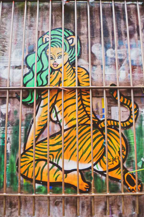 street art by Saki&Bitches in Shoreditch featuring a pin-up cat-like woman