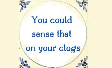 Typical Dutch ceramic tile with the funny Dutch saying: You could sense that on your clogs