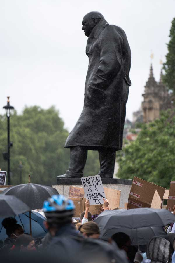 Black Lives Matter protesters in front of Winston Churchill's statue in London