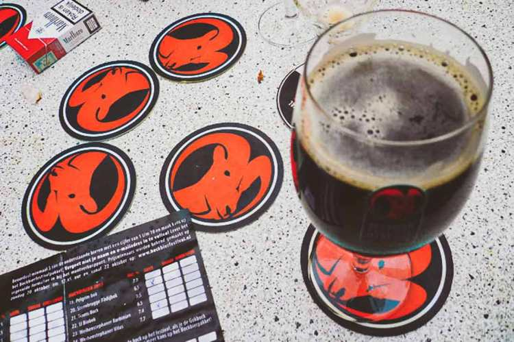 Close-up of a festival beer glass and special bock beer coasters