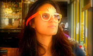 portrait of me wearing oversized paper glasses in orange, the national colour of the Netherlands