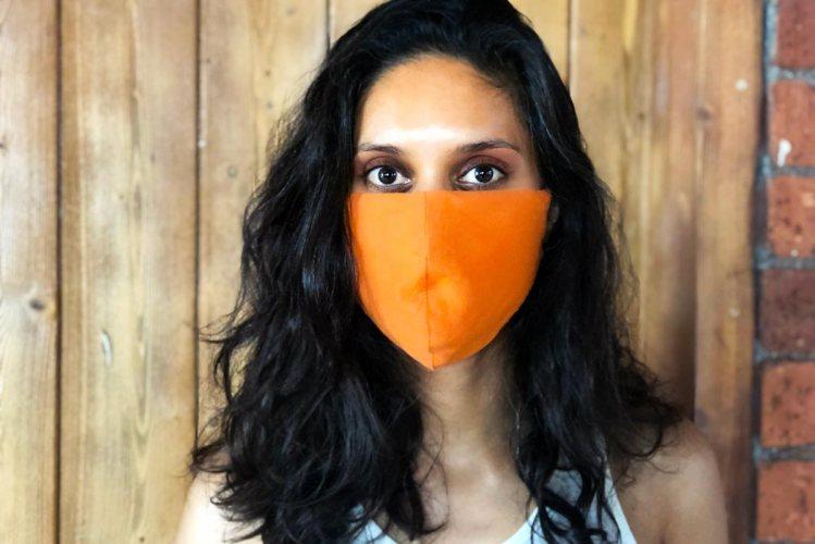 Close-up of Zarina wearing a corona face mask