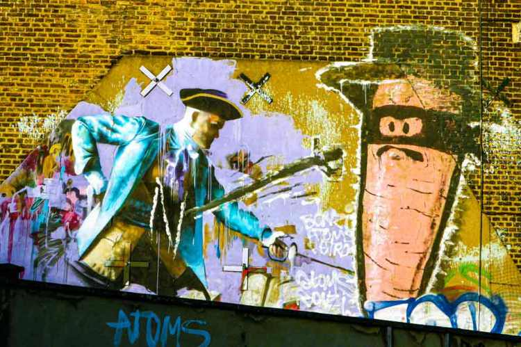 Conor Harrington mural of a baroque-style soldier fighting a giant carrot wearing a Zorro mask and hat