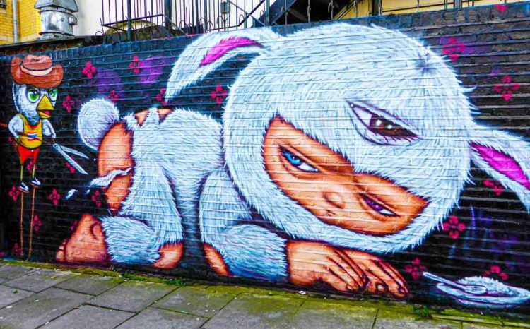 mural by Alex Face of his signature baby figure wearing a bunny suit