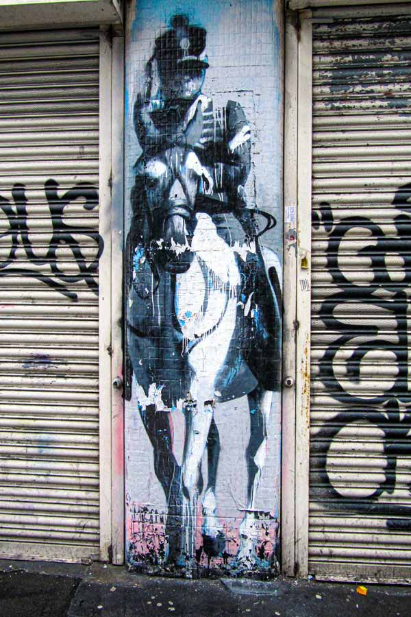 street art in Shoreditch by Conor Harrington of a baroque-style soldier on a horse