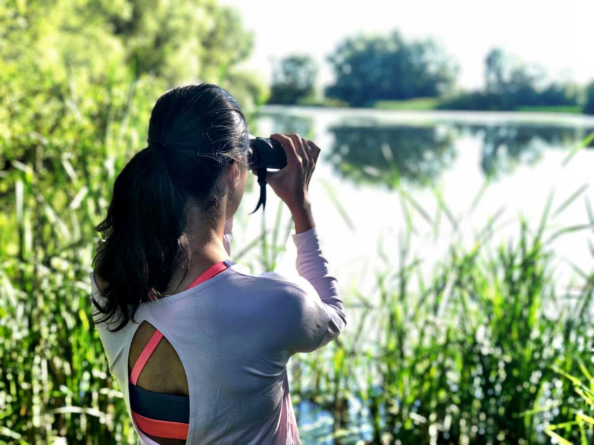 Zarina birdwatching with binoculars