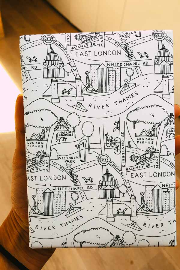 Mini Hoxton Press book wrapped in paper with drawings of East London