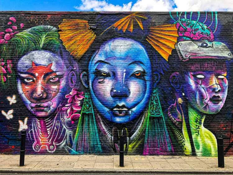 Jim Vision mural in Shoreditch of three female figures made out of abstract forms
