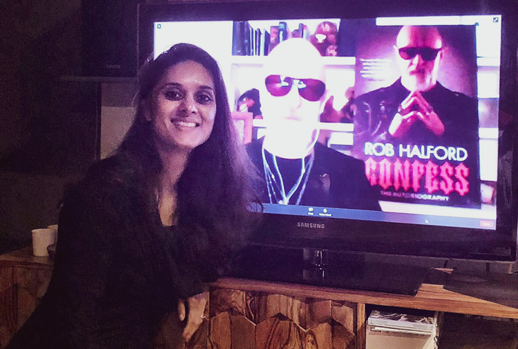 Zarina next to the TV during the live Q&A with Rob Halford for his biography