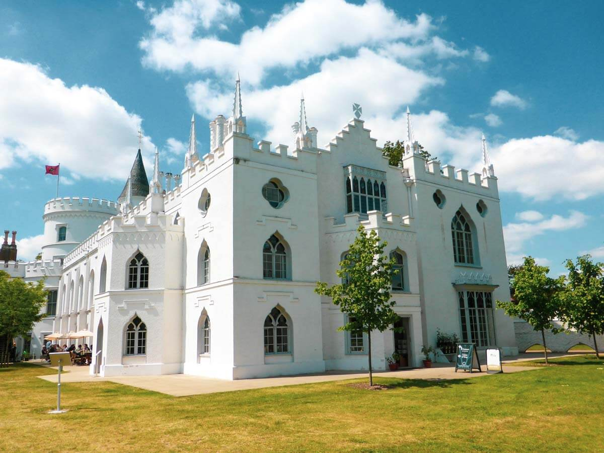 exterior of the Strawberry Hill House which looks like a white-clad castle from the outside