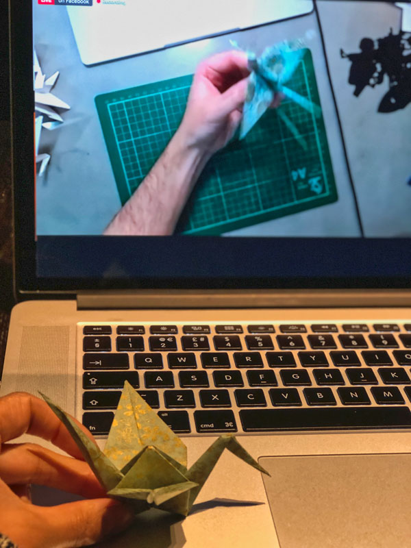 Showing the paper crane I made during the Origami workshop with Paperboyo