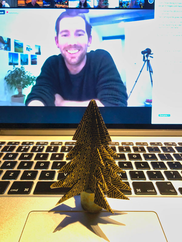 Showing the paper Christmas tree I made during the origami workshop with Paperboyo