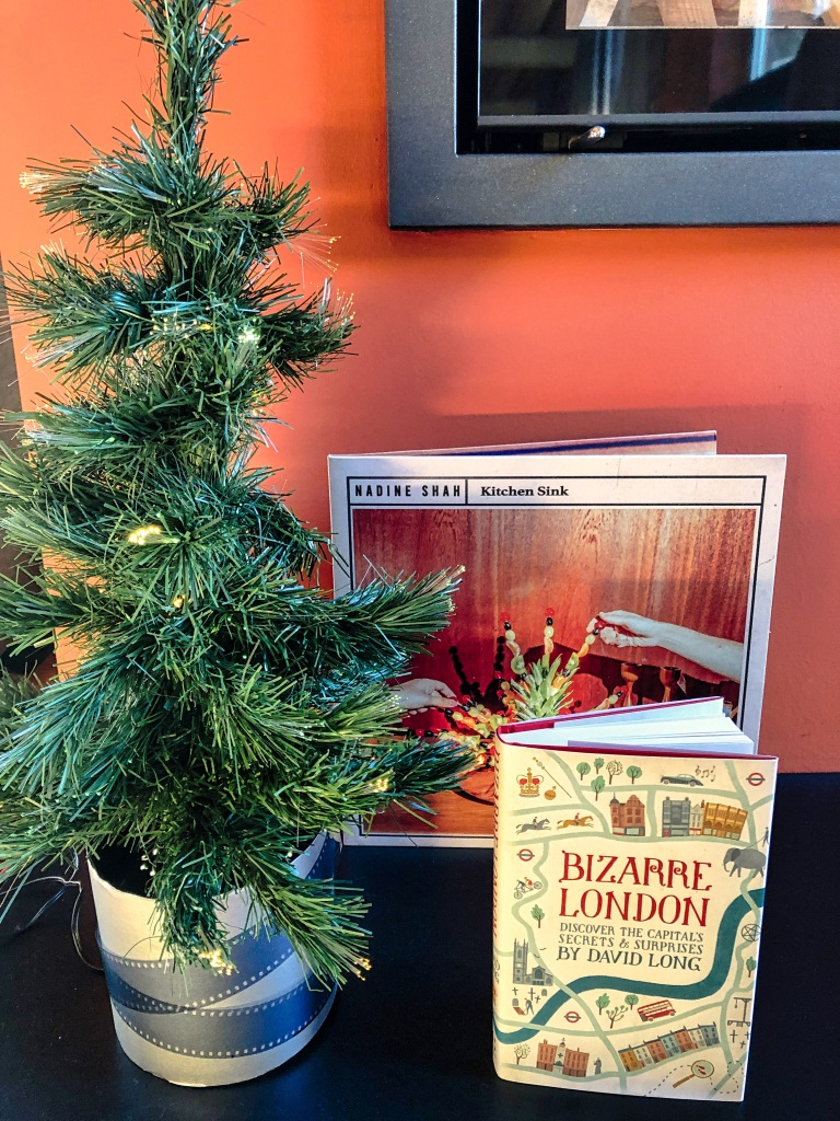 mini fake Christmas tree with the presents I received: Nadine Shah's album Kitchen Sink and the book Bizarre London by David Long